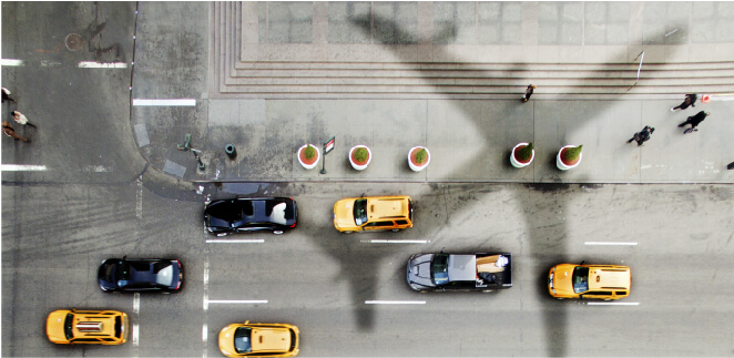 airplane over taxis