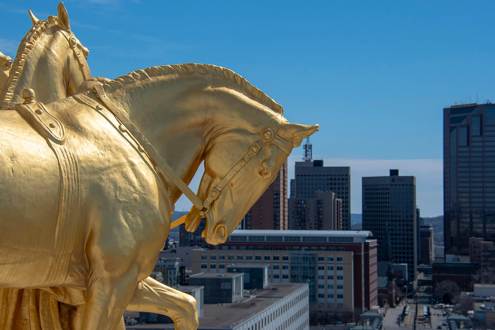 Golden horse statue on top of the state capitol building in downtown Saint Paul