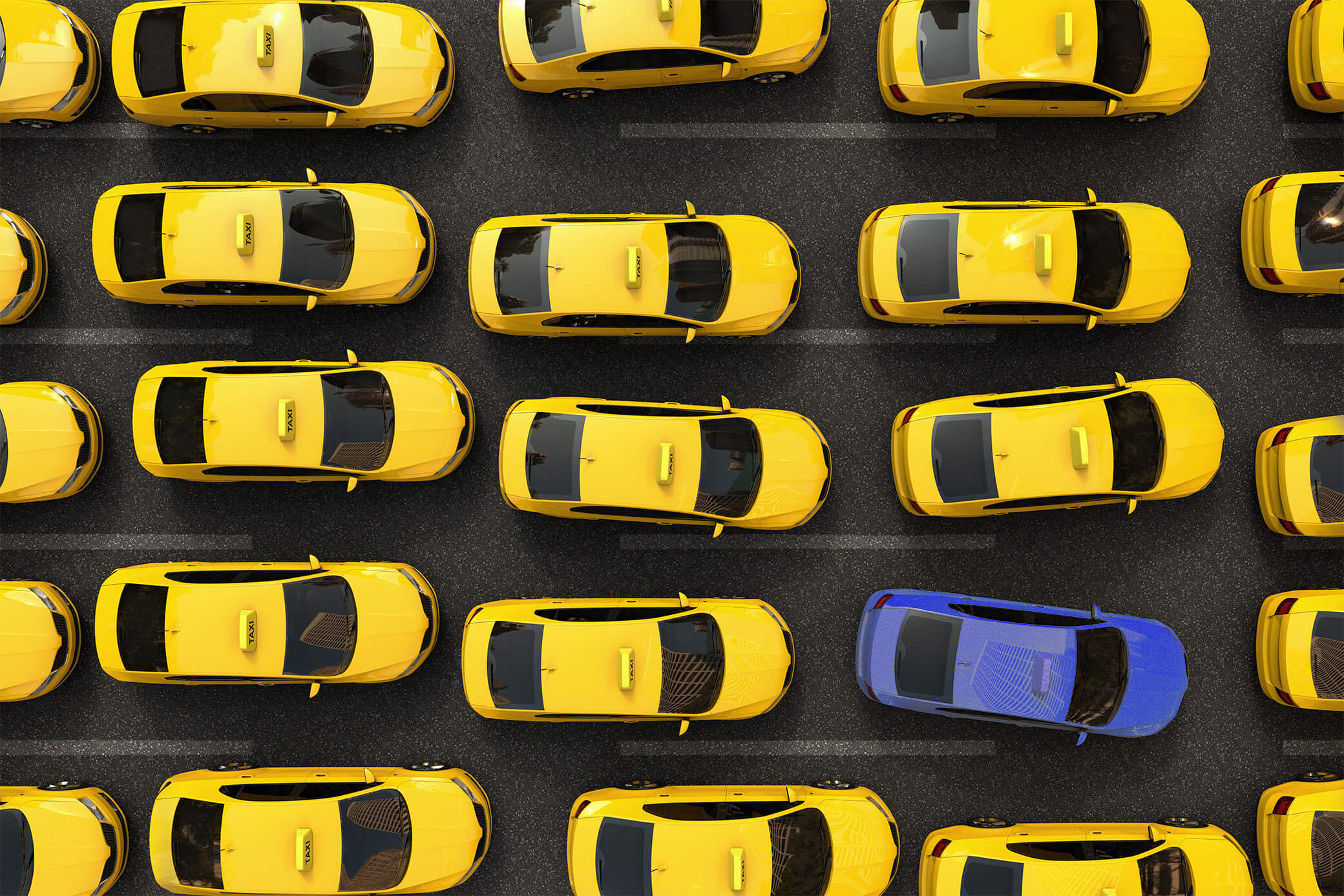 Bird's eye view of yellow cabs with one blue taxi